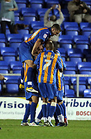 Pictured: Nicky Wroe of Shrewsbury celebrating his goal mobbed by team mates. Tuesday 23 August 2011<br />