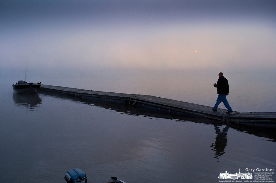 Fisherman readies his boat at one of the docks on Hoover Reservoir on a foggy Saturday morning.