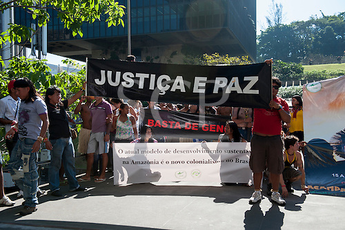 "Indigenous people with a banner, ""Justice and Peace"", protest outside BNDES, the Brazilian Development Bank, after marching from the People's Summit at the United Nations Conference on Sustainable Development (Rio+20), Rio de Janeiro, Brazil, 18th June 2012. Photo © Sue Cunningham."
