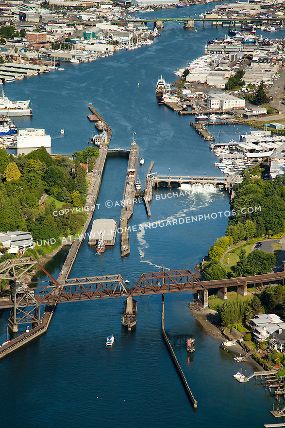 gravel barge passing through the Ballard Locks that connect Puget Sound with freshwater Lake Union and Lake Washington; Seattle, WA