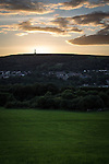 © Joel Goodman - 07973 332324 . 14/09/2013 . Bury , UK . As warnings of heavy winds and gales are issued for the North of the UK , a stunning Autumn sunset blazes behind the Peel Monument , on Harcles Hill , high above the town of Ramsbottom , in Bury , this evening (Saturday 14th September) . The stone tower is dedicated to former British Prime Minister and founder of the police force , Sir Robert Peel . Photo credit : Joel Goodman