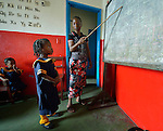 As a teacher points to the blackboard, a girl recites her lesson during class in a day care center in Monrovia, Liberia, sponsored by United Methodist Women.