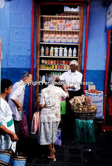 PORT LOUIS, MAURITIUS - JULY 2 :  .People buying at the local fruit market on July 2, 2003, in Port Louis, Mauritius. The island, located in the Indian Ocean, is a popular place for tourists with unspoiled beaches and nature. .(Per-Anders Pettersson/Getty Images).