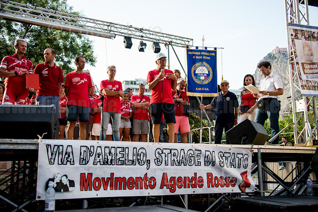 """""""We are here to fight for Truth and Justice"""" - Salvatore Borsellino - Magistrate Paolo Borsellino's brother and founder of the Moviment Agende Rosse/Red Notebooks Movement, http://19luglio1992.com.<br /> <br /> Palermo (Sicily - Italy), 19/07/2017. """"Basta depistaggi e omertà di Stato!"""" (""""Stop disinformation & omertá by the State!"""")(1). Public event to commemorate the 25th Anniversary of the assassination of the anti-mafia Magistrate Paolo Borsellino along with five of his police """"scorta"""" (Escorts from the special branch of the Italian police force who protect Judges): Agostino Catalano, Emanuela Loi (The first Italian female member of the police special branch and the first woman of this branch to be killed on duty), Vincenzo Li Muli, Walter Eddie Cosina and Claudio Traina. The event was held at Via D'Amelio, the road where Borsellino was killed. Family members of mafia victims, amongst others, made speeches about their dramatic experiences, mafia violence and unpunished crimes, State cover-ups, silence ('omertá'), and misinformation. Speakers included, amongst others, Vincenzo Agostino & Augusta Schiera, Salvatore & Cristina Catalano, Graziella Accetta, Massimo Sole, Paola Caccia, Luciano Traina, Angela Manca, Stefano Mormile, Ferdinando Imposimato, Judge Nino Di Matteo. The event ended with the screening of the RAI docu-fiction, 'Adesso Tocca A Me' ('Now it's My Turn' - Watch it here: http://bit.ly/2w3WJUX ).<br /> <br /> For more info & a video of the event please click here: http://bit.ly/2eQfNT3 & http://bit.ly/2eQbmrj & http://19luglio1992.com & http://bit.ly/2he8hCj<br /> <br /> (1) 'Omerta' is the term used in Italy to refer to the code of silence used by mafia organisations, as well as the culture of silence that is entrenched in society at large (especially among victims of mafia crimes, as they fear recriminations), about the existence of organised crime and its activities."""