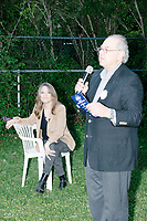 Former US Representative Paul Hodes asks attendees for donations and campaign signups after Democratic presidential candidate and spiritual guru Marianne Williamson spoke to a small crowd in the back yard of Kathleen O'Donnell at a campaign house party event in Keene, New Hampshire, on Wed., May 22, 2019. Hodes is the NH State Director and Senior Campaign Advisor for Marianne Williamson.