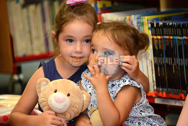 April and Summer Churchill at the children's storytelling at Drogheda Library  on Saturday. Photo: Andy Spearman.
