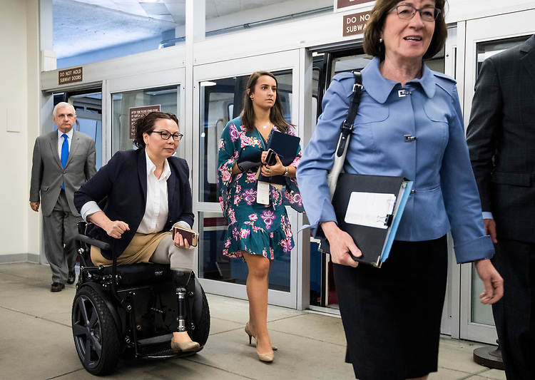 UNITED STATES - JULY 31: From left, Sen. Jack Reed, D-R.I., Sen. Tammy Duckworth, D-Ill., and Sen. Susan Collins, R-Maine, arrive in the Capitol via the Senate subway on Tuesday, July 31, 2018. (Photo By Bill Clark/CQ Roll Call)
