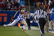 December 7, 2013  (Charlotte, North Carolina)  Florida State Seminoles quarterback Jameis Winston #5 rushes the ball as Duke Blue Devils safety Dwayne Norman #40 makes a hit out of bounds in the 2013 ACC Championship game. Norman was charged with a personal foul. (Photo by Don Baxter/Media Images International)