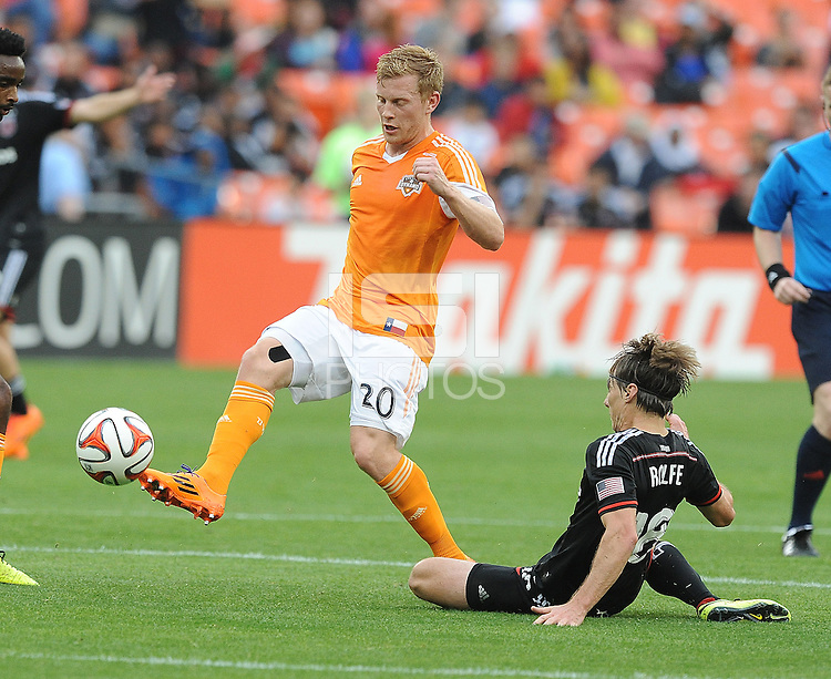 Washington D.C. - May 17, 2014: Andrew Driver (20) of Houston Dynamo goes against Chris Rolfe (18) of D.C. United. D.C. United defeated  the Houston Dynamo 2-0 during a Major League Soccer match for the 2014 season at RFK Stadium.