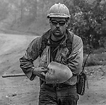 September 2, 1987 Buck Meadows, California – Stanislaus Complex Fire -- Sierra Hotshots Captain Mike Freed hikes down the road. The Stanislaus Complex Fire consumed 28 structures and 145,980 acres.  One US Forest Service firefighter, David Ross Erickson, died from a tree-felling accident.