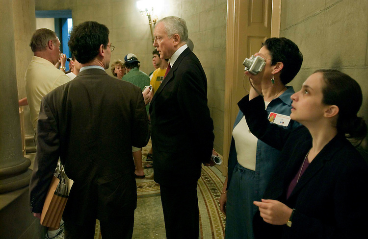 06/28/05.SENATE POLICY LUNCHES--Surrounded by tourists near the Rotunda, Senate Orrin G. Hatch, R-Utah, talks to a reporter after the Senate GOP policy luncheon..CONGRESSIONAL QUARTERLY PHOTO BY SCOTT J. FERRELL