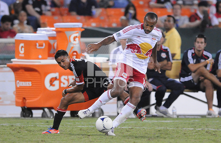New York Red Bulls forward Thierry Henry (14) shields the ball from D.C. United defendr Andy Najar (14) The New York Red Bulls tied D.C. United 2-2 at RFK Stadium, Wednesday August 29, 2012.