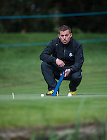 19.05.2015. Wentworth, England. BMW PGA Golf Championship. Practice Day.  Ground staff check the speed of the greens during the practice round of the 2015 BMW PGA Championship from The West Course Wentworth Golf Club
