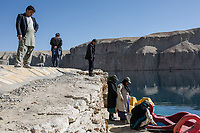 Amina and her colleagues are cleaning the approach of the lake under the surveillance of their supervisor who prepares a visit of the governeur of Bamyan, Band-e Amir, Afghanistan, 8th November 2017.<br /> <br /> Amina et ses collègues nettoient le bord du lac sous la surveillance de leur patron qui prépare une visite du gouverneur de Bamyan, Band-e Amir, Afghanistan, 8th November 2017.