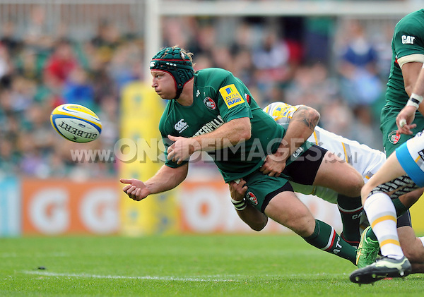 Thomas Waldrom looks to offload the ball after being tackled. Aviva Premiership match, between Leicester Tigers and Worcester Warriors on September 8, 2013 at Welford Road in Leicester, England. Photo by: Patrick Khachfe / JMP