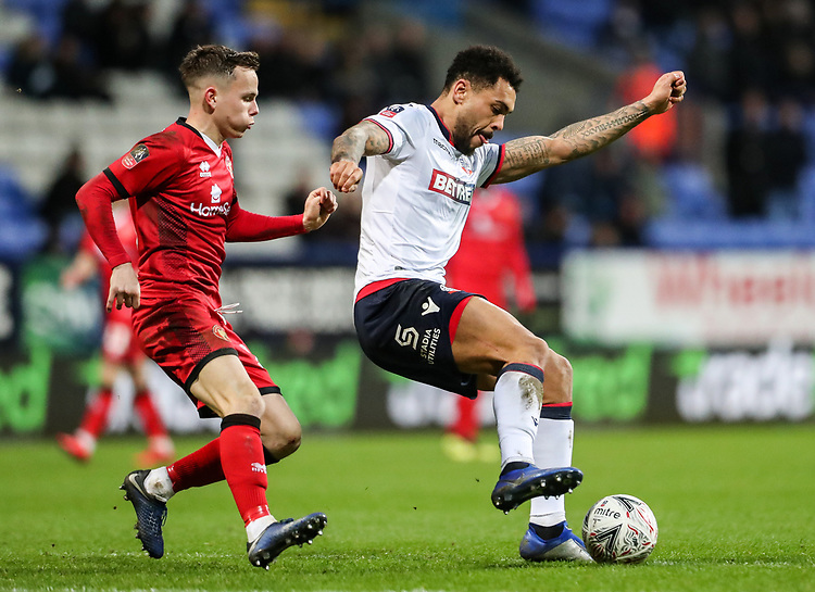 Bolton Wanderers' Josh Magennis holds off Walsall's Liam Kinsella<br /> <br /> Photographer Andrew Kearns/CameraSport<br /> <br /> Emirates FA Cup Third Round - Bolton Wanderers v Walsall - Saturday 5th January 2019 - University of Bolton Stadium - Bolton<br />  <br /> World Copyright © 2019 CameraSport. All rights reserved. 43 Linden Ave. Countesthorpe. Leicester. England. LE8 5PG - Tel: +44 (0) 116 277 4147 - admin@camerasport.com - www.camerasport.com