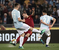 Calcio, Serie A: S.S. Lazio - A.S. Roma, stadio Olimpico, Roma, 15 aprile 2018. <br /> Roma's Edin Dzeko (c) in action with Lazio's Adam Marusic (l) and Luis Felipe Ramos (r) during the Italian Serie A football match between S.S. Lazio and A.S. Roma at Rome's Olympic stadium, Rome on April 15, 2018.<br /> UPDATE IMAGES PRESS/Isabella Bonotto
