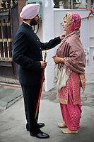 British/Punjabi couple Lindsay and Navneet Singh wait to be taken to their wedding ceremony at a gurdwara in Amritsar.