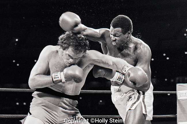 "Larry Holmes v. Randell ""Tex"" Cobb.  Holmes W UD15.  WBC Heavyweight title."