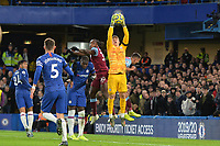 Kepa Arrizabalaga Of Chelsea FC jumps and catches a cross under pressure from Michail Antonio during Chelsea vs West Ham United, Premier League Football at Stamford Bridge on 30th November 2019