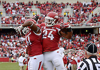 NWA Democrat-Gazette/BEN GOFF @NWABENGOFF<br /> Chris Jones and Kody Walker (24) celebrate after Walker scored in the third overtime period against Auburn on Saturday Oct. 24, 2014 during the game in Razorback Stadium in Fayetteville.