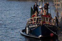 Benedict Cumberbatch and Martin Freeman seen filming scenes on a fishing boat of hit BBC series Sherlock in Cardiff, Wales, UK