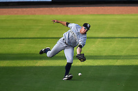 Tampa Yankees outfielder Cody Grice (19) just misses a shoestring catch during a game against the Lakeland Flying Tigers on April 5, 2014 at Joker Marchant Stadium in Lakeland, Florida.  Lakeland defeated Tampa 3-0.  (Mike Janes/Four Seam Images)