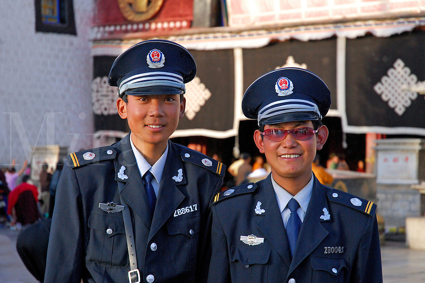 Chinese police on duty outside the Jokhang Temple, Lhasa, Tibet.