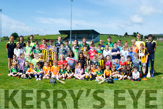 Young Kids being thought the skills of hurling and Comogie at the Abbeydorney GAA club last Monday.