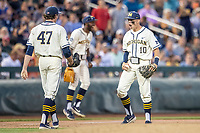 Michigan Wolverines third baseman Blake Nelson (10) celebrates with pitcher Tommy Henry (47) after tagging out Vanderbilt Commodores base runner Austin Martin (16) during the eighth inning of Game 1 of the NCAA College World Series Finals on June 24, 2019 at TD Ameritrade Park in Omaha, Nebraska. Michigan defeated Vanderbilt 7-4. (Andrew Woolley/Four Seam Images)