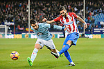 Yannick Ferreira Carrasco (r) of Atletico de Madrid battles for the ball with Hugo Mallo Novegil of RC Celta de Vigo during their La Liga match between Atletico de Madrid and RC Celta de Vigo at the Vicente Calderón Stadium on 12 February 2017 in Madrid, Spain. Photo by Diego Gonzalez Souto / Power Sport Images