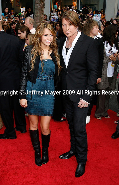 "HOLLYWOOD, CA. - April 02: Miley Cyrus and Billy Ray Cyrus arrive at the premiere of Walt Disney Picture's ""Hannah Montana: The Movie"" held at the El Captian Theatre on April 2, 2009 in Hollywood, California."