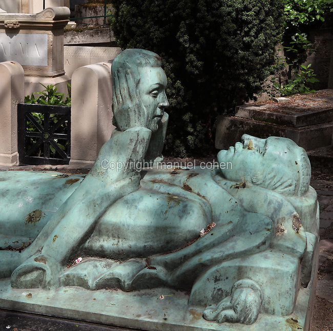Tomb of Fernand Arbelot (1880 - 1942), with a bronze patina gisant statue by Adolphe Wansart (1873-1954), Pere Lachaise Cemetery (Cimetiere du Pere-Lachaise) Paris, France, opened 1804, designed by Alexandre-Theodore Brongniart. Named after Pere Francois de la Chaise (1624-1709), confessor to Louis XIV (1638-1713), who lived in the Jesuit house on the site of the chapel. Picture by Manuel Cohen