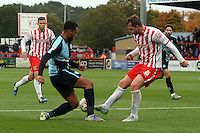 Aaron Holloway of Wycombe Wanderers and Mark Hughes of Stevenage in action during the Sky Bet League 2 match between Stevenage and Wycombe Wanderers at the Lamex Stadium, Stevenage, England on 17 October 2015. Photo by PRiME Media Images.