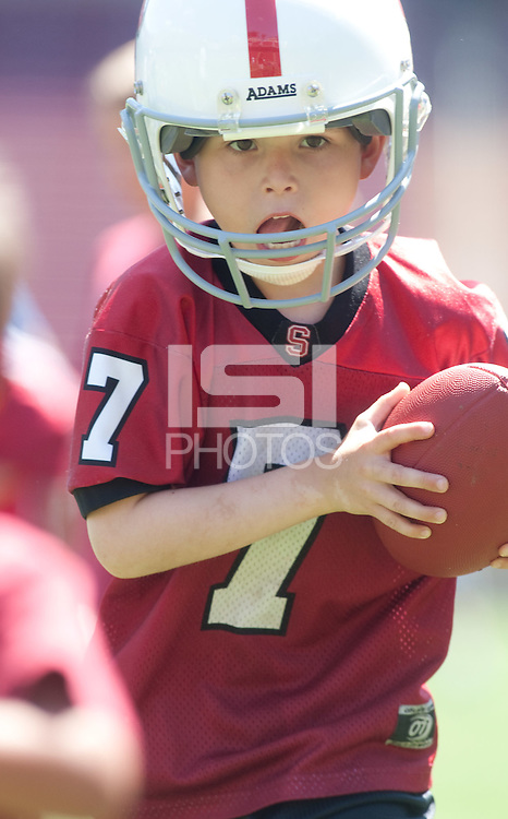 STANFORD CA - August 21, 2011: The Stanford Cardinal Football Open House took place Sunday, August 21, 2011 at Stanford Stadium. <br /> <br /> Youngsters got to practice at skills stations run by Stanford Football coaches. Fans of all ages were able to watch the 2011 squad practice, get autographs from their favorite players, and have their pictures taken with the 2011 Orange Bowl Trophy.