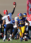 BROOKINGS, SD - OCTOBER 25:  Auston LeBlance #43 from South Dakota State University applies pressure to Hunter Wells #6 from Youngstown State in the second quarter of their game Saturday afternoon at Coughlin Alumni Stadium in Brookings. (Photo by Dave Eggen/Inertia)