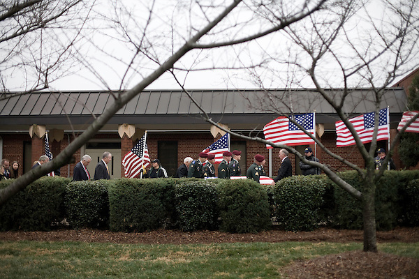 December 21, 2007. Charlotte, NC.. A funeral was held for Cpl. Joshua C. Blaney in Charlotte, NC. Cpl. Blaney died on December 12 from injuries sustained when an IED exploded near his vehicle in Afghanistan. He was 25.. Cpl. Blaney's  coffin is carried into  Cedar Grove Baptist Church by the honor guard from Ft. Bragg.