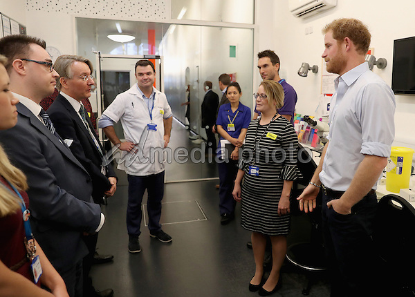 14 July 2016 - London, England - Prince Harry chats with staff as visits Burrell Street Sexual Health Clinic in London. Prince Harry was visiting the clinic, run by Guy's and St Thomas NHS Foundation to promote the importance of getting tested for HIV and other STDs. Photo Credit: Alpha Press/AdMedia