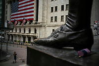 NEW YORK, NY - APRIL 20: A woman walks near the New York Stock Exchange building on April 20, 2020. in New York City. United States. U.S. President Trump is looking to get many Americans back to work as soon as possible, but also he recognizes that cities like New York will need to go slow. (Photo by Eduardo MunozAlvarez/VIEWpress)