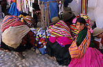 Paucartambo, Peru. Women and children with traditional colourful woven mantas.