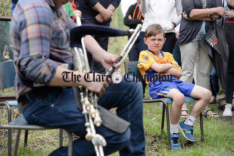 Young Colin Griffin looks on as Piper Fergal Breen performs at the unveiling of a memorial at the house where the blind piper Patrick O Brien was born at Labasheeda. Photograph by John Kelly.