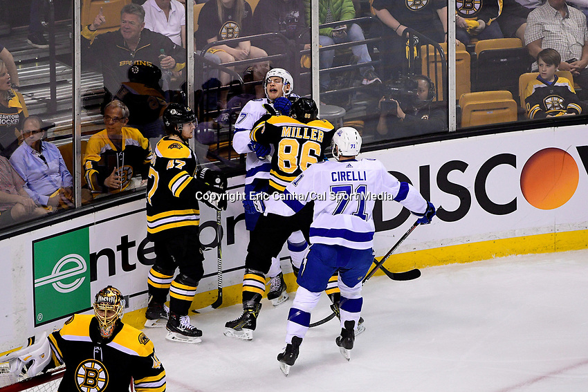 May 2, 2018: Boston Bruins defenseman Kevan Miller (86) pins Tampa Bay Lightning center Yanni Gourde (37) to the glass during game three of the second round of the National Hockey League's Eastern Conference Stanley Cup playoffs between the Tampa Bay Lightning and the Boston Bruins held at TD Garden, in Boston, Mass. Tampa Bay defeats Boston 4-1. Eric Canha/CSM