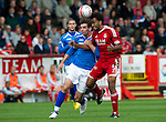 Aberdeen v St Johnstone... 23.07.11   SPL Week 1.Cillian Sheridan battles with Youl Mawene.Picture by Graeme Hart..Copyright Perthshire Picture Agency.Tel: 01738 623350  Mobile: 07990 594431