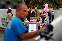 San Diego, CA, Saturday, April 20 2008:  Raphael Ramos (18), second from right, attends a  charity drive at Genie Car Wash at 3949 W Point Loma Blvd.  Ramos' mother Rosa Lisowski has been missing since March 24 2008. The Genie Car Wash donated $5 from every car wash bought during the event. The roughly $3000 raised will go into a fund to help Lisowski's children.