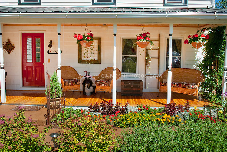 Beautiful Front Porch With Plants Wicker Furniture
