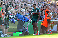 Manu Tuilagi leaves the field injured after suffering a torn pectoral muscle during the match. Aviva Premiership match, between Leicester Tigers and Newcastle Falcons on September 21, 2013 at Welford Road in Leicester, England. Photo by: Patrick Khachfe / JMP