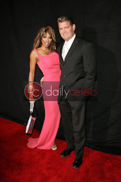 "Traci Bingham and John Edward Yarbrough<br />at the Premiere Screening of ""Nip/Tuck"" Season 3. The El Capitan Theatre, Hollywood, CA. 09-10-05<br />Jason Kirk/DailyCeleb.com 818-249-4998"