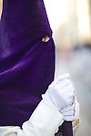 Hooded penitent with a rosary, Holy Week, Seville, Spain
