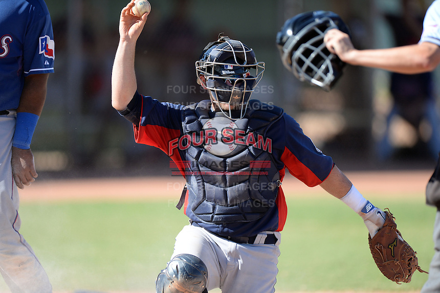 Cleveland Indians catcher Shane Rowland (8) shows the ball to the umpire after tagging a runner at home during an Instructional League game against the Texas Rangers on October 4, 2013 at Surprise Stadium Training Complex in Surprise, Arizona.  (Mike Janes/Four Seam Images)
