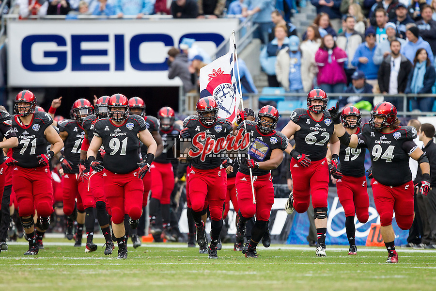 The Cincinnati Bearcats take the field prior to the start of the Belk Bowl against the North Carolina Tar Heels at Bank of America Stadium on December 28, 2013 in Charlotte, North Carolina.  The Tar Heels defeated the Bearcats 39-17.   (Brian Westerholt/Sports On Film)